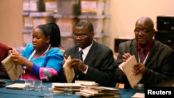 Zimbabwe Election Commission (ZEC) officials count special votes in Harare, July 19, 2013