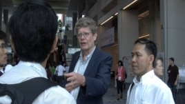 Peter Godwin, an international AIDS consultant (left) and Sim Kimsen, deputy chairman of the Cambodia's National AIDS Authority (right).