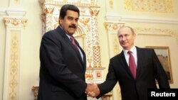 FILE - Russian President Vladimir Putin (R) welcomes Venezuela's President Nicolas Maduro in Moscow in this January 15, 2015, handout from the Miraflores Palace.