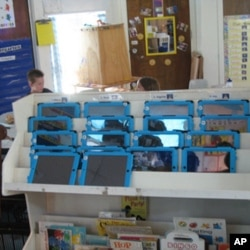 Nearly 300 kindergarteners are taking part in the iPad learning initiative in Auburn, Maine.