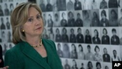 U.S. Secretary of State Hillary Rodham Clinton looks at a wall of faces of those killed by the Khmer Rouge regime, during a tour of the Tuol Sleng Genocide Museum, formerly the regime's notorious S-21 prison, on Monday, Nov. 1, 2010, in Phnom Penh, Cambo