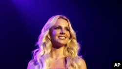 Spears smiles on stage at the 2011 Wango Tango concert in Los Angeles.