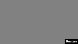 Representatives from Alibaba Group Holding arrive for the company's roadshow meeting in New York, Sept. 8, 2014.