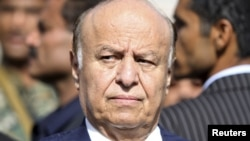 Yemeni President Abed Rabbo Mansour Hadi looks on during a funeral service for Major General Salem Ali Qatan, the commander of military forces in the south of Yemen, Sanaa, June 19, 2012.