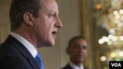 ນາຍົກລັດຖະມົນຕີອັງກິດ ທ່ານ David Cameron ແລະປະທານາທິບໍດີສະຫະລັດ ທ່ານ Barack Obama.