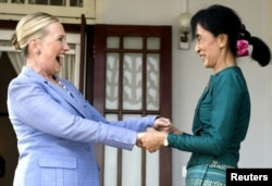 FILE - Pro-democracy leader Aung San Suu Kyi Clinton after meeting at Suu Kyi's residence in Rangoon, Burma, December 2, 2011.