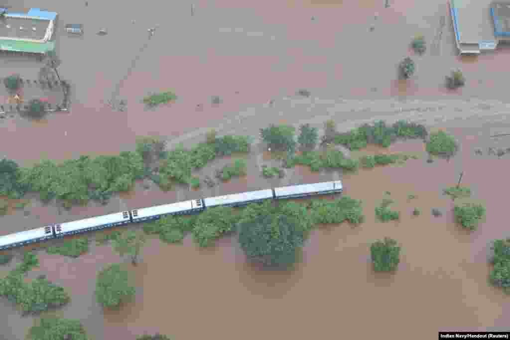 An aerial view shows a stranded passenger train in a flooded area near Badlapur, in the western state of Maharashtra, India, July 27, 2019.