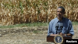 U.S. President Barack Obama speaks after he tours the McIntosh family farm with the owners to view drought ridden fields of corn in Missouri Valley, Iowa, August 13, 2012