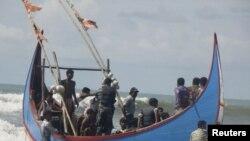 Algunos de los Primeros rescatados Que Se dirigían a Malasia.