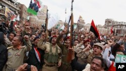After the start of a Saudi-led airstrike campaign, Shiite rebels known as Houthis protest in Sana'a, March 26, 2015.