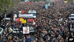 "Thousands of people march during the funeral of Tahir Elci, president of the Diyarbakir Bar Association and a leading human rights defender, in Diyarbakir, Turkey, Nov. 29, 2015. Elci was killed Saturday while making a press statement intended to call attention to damage done to the 1,500-year-old Four-Legged Minaret Mosque by recent clashes between Turkish security forces and Kurdistan Workers' Party militants. The banner in Turkish and Kurdish reads: "" We will not forget you."""