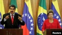 """Maduro, un aliado político de Rousseff, acusó al mandatario estadounidense, Barack Obama, de intentar """"acabar con las corrientes progresistas en América Latina""""."""