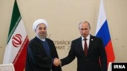 دیدار حسن روحانی رئیس جمهوری ایران (چپ) و ولادیمیر پوتین رئیس جمهوری روسیه در آستراخان - ۷ مهر ۱۳۹۳