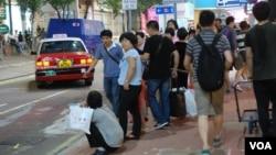 中國實施新《旅遊法》後首個十一黃金週,訪港大陸旅客人次較去年同期上升