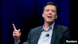 FILE - Former FBI director James Comey speaks during an interview at George Washington University in Washington, April 30, 2018.