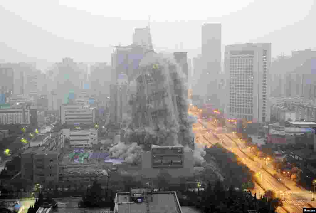 A building crumbles during a controlled demolition in Xi'an, Shaanxi province, China.