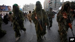 Masked Palestinian members of the Ezz Al-Din Al Qassam brigade, the military wing of Hamas in Gaza City, Nov. 14, 2013.