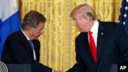 President Donald Trump shakes hands with Finnish President Sauli Niinisto during their joint news conference, Aug. 28, 2017, in the East Room of the White House in Washington.