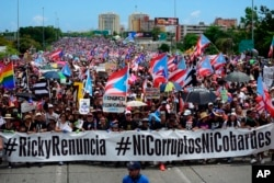Miles de puertorriqueños se reunieron en una importante carretera de Puerto Rico, el lunes 22 de julio de 2019, para la que podría ser una de las protestas más grandes que se haya visto en el territorio estadounidense, con los isleños furiosos y exigiendo la renuncia del gobernador Ricardo Rossello, en San Juan, Puerto Rico.