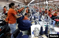Paraguayan workers assemble clothes for Brazilian retailer Riachuelo at the factory of Texcin in Limpio, Paraguay Dec. 20, 2016.