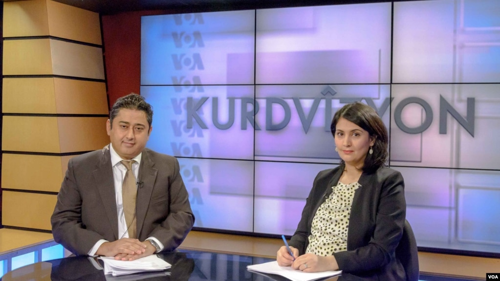 Kurdvizyon hosts Mutlu Civiroglu (L) and Ruken Isik