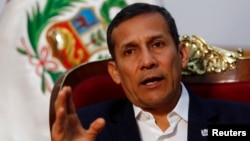 FILE - Peru's President Ollanta Humala speaks during an interview at the government palace in Lima, July 12, 2014.