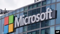 FILE - This April 12, 2016 file photo shows the Microsoft logo in Issy-les-Moulineaux, outside Paris, France.