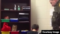 A screengrab from the video showing officer Kevin Sumner handcuffing one of the students.