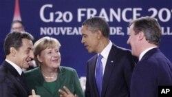 奧巴馬總統和英國首相卡梅倫(右)11月3日在法國參加20國首腦會議。 圖中左為法國總統薩科齊﹑左二德國總理默克爾