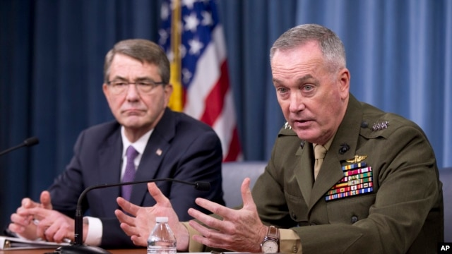 Joint Chiefs Chairman Gen. Joseph Dunford (R) with Defense Secretary Ash Carter, is seen during a news conference at the Pentagon, March 25, 2016.
