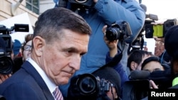 Former U.S. national security adviser Michael Flynn passes by members of the media as he departs after his sentencing was delayed at U.S. District Court in Washington, U.S., December 18, 2018.