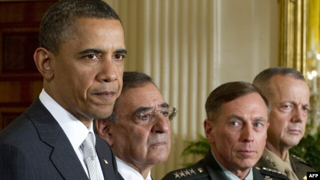 President Barack Obama, and from the left, Leon Panetta, General David Petraeus, and General John Allen in the White House in Washington, D.C., April 28, 2011