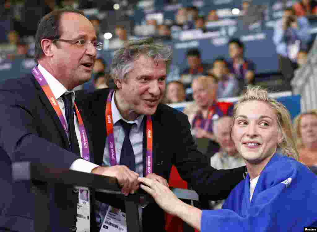 France's President Francois Hollande congratulates French athlete August 5, 2012.