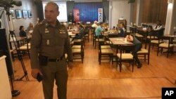 "A Thai policeman stands inside Foreign Correspondents' Club of Thailand during an event titled: ""Will Myanmar's General Ever Face Justice for International Crimes"" in Bangkok, Thailand, Sept. 10, 2018."