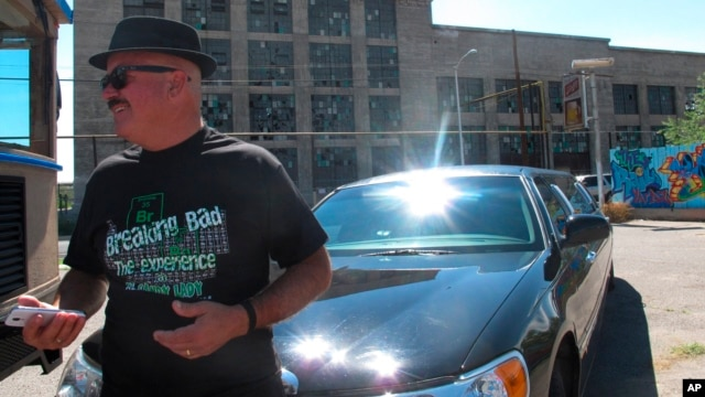 "Limousine tour guide Harold Davis is dressed as ""Breaking Bad"" character Walter White, as Albuquerque tourists officials get ready for an event celebrating the premiere of the final season of AMC's TV series, Aug. 9, 2013."