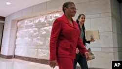 FILE - Rep. Karen Bass, D-Calif., walks through the Capitol Visitor's Center on Capitol Hill in Washington.