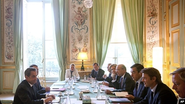 French President Nicolas Sarkozy, left, speaks during a special meeting on the financial crisis at the Elysee Palace in Paris, August 10, 2011