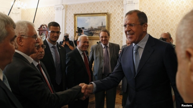 Russia's Foreign Minister Sergei Lavrov (R) meets with Syrian opposition leaders in Moscow July 11, 2012.