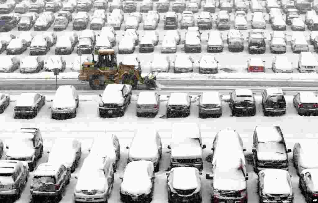 A snow plow clears a parking lot at O'Hare International Airport in Chicago, March 5, 2013.