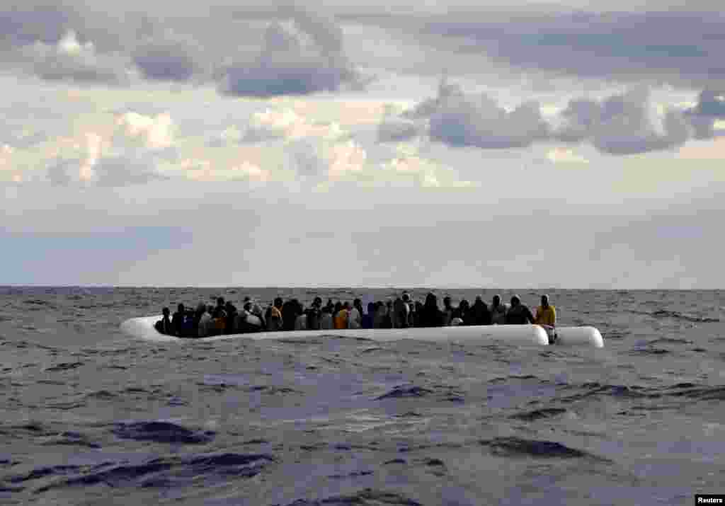 An overcrowded raft drifts out of control in the central Mediterranean Sea, some 36 nautical miles off the Libyan coast, before lifeguards from the Spanish NGO Proactiva Open Arms rescue all 112 on aboard, including two pregnant women and five children.