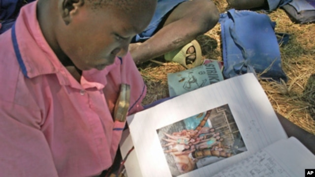 A Ugandan student reads a letter from her American pen pal.
