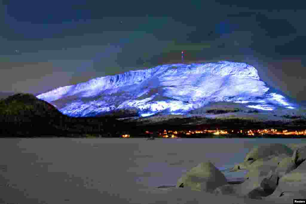 The Saana fell is lighted as part of the Luminous Finland 100 project, a light art event that will be held in honor of the 100th anniversary of Finland's independence, in Kilpisjarvi, Finland.