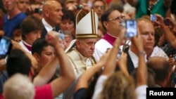 Pope Francis arrives to lead a mass marking World Day of Prayer for the Care of Creation in Saint Peter's Basilica at the Vatican, Sept. 1, 2015.