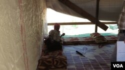 A Syrian refugee in his makeshift home in Lebanon's Beka'a Valley, Sept. 2, 2013. (Heather Murdock for VOA)