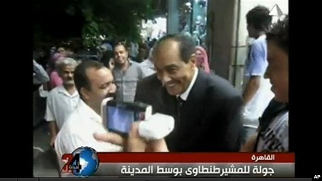 Field Marshal Mohammed Hussein Tantawi, on video seen widely on YouTube, strolls the streets of Cairo in a tailored dark suit instead of his military uniform.
