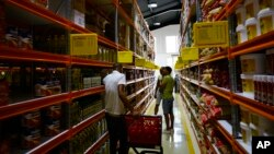 Shoppers walk through the aisles of a new bulk goods store in Havana, Cuba, Monday, July 11, 2016.