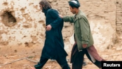 جان واکر لیند در سال ۲۰۰۱ در افغانستان بازداشت شد