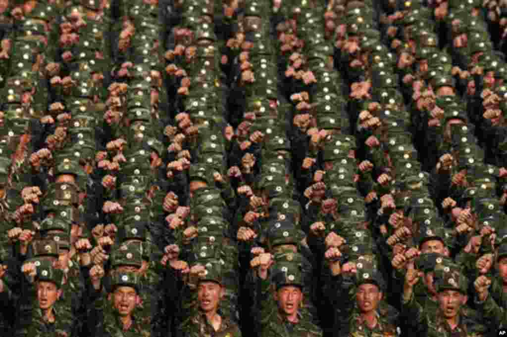 "North Korean soldiers chant at Kim Il Sung Square in central Pyongyang, North Korea, during a rally denouncing South Korean President Lee Myung-bak on Friday, April 20, 2012. North Koreans said Lee's radio comments about North Korea last week ""hurt the di"