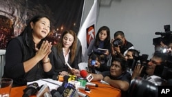 Presidential candidate Keiko Fujimori talks to the media during a meeting with young members of her party in Lima, Peru, May 9, 2011