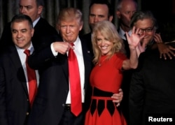 FILE - U.S. President-elect Donald Trump and his campaign manager Kellyanne Conway greet supporters during his election night rally in Manhattan, New York, Nov. 9, 2016.